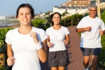 happy-active-family-jogging-in-